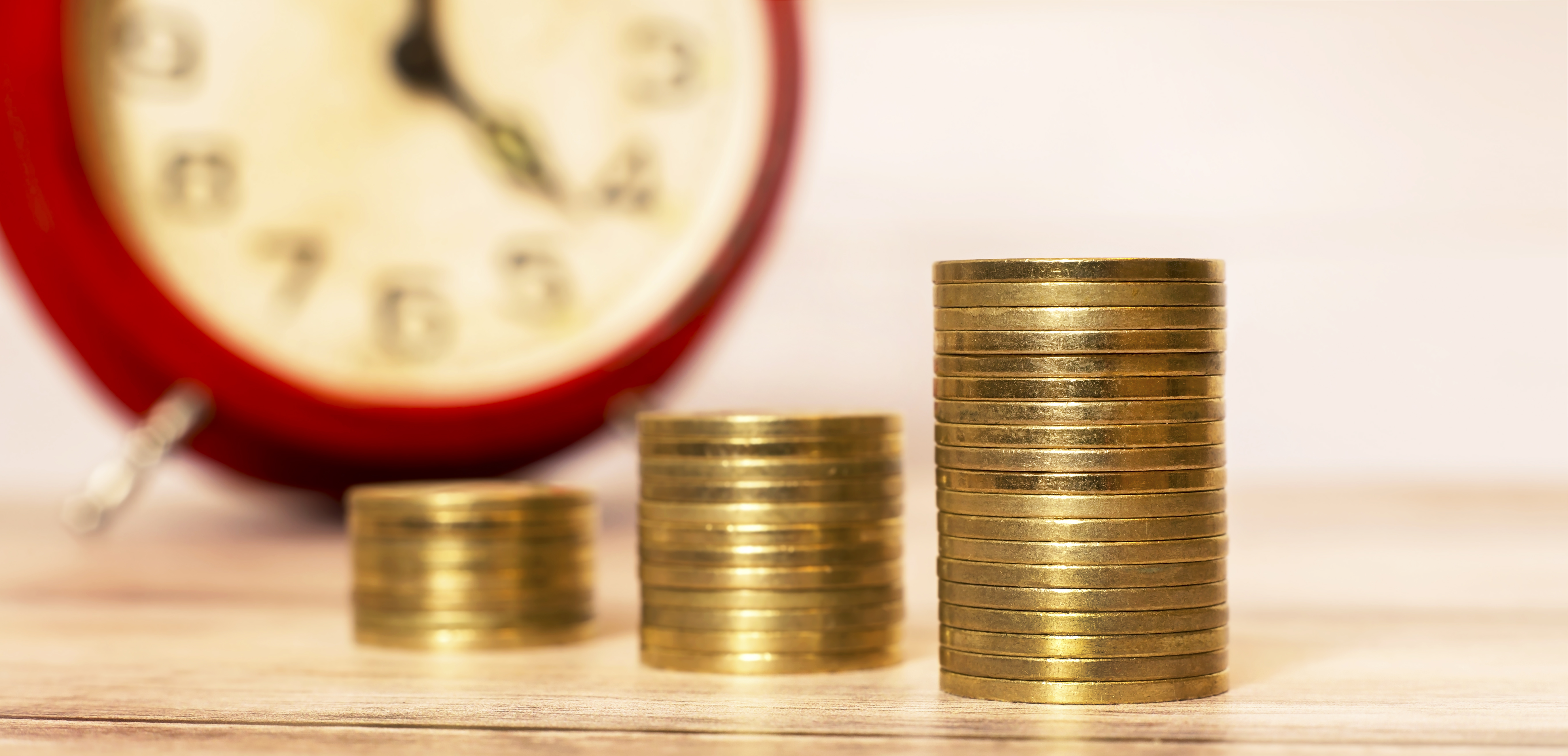 time-to-savings-money-coins-with-alarm-clock-PCUPB39